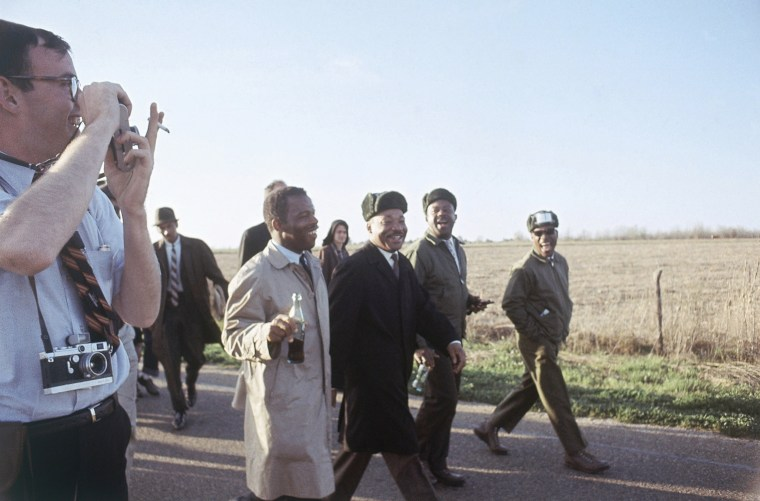 Image: John Lewis, Dr. Martin Luther King Jr. and Ralph Abernathy, march for civil rights from Selma to Montgomery, Alabama on March 19, 1965