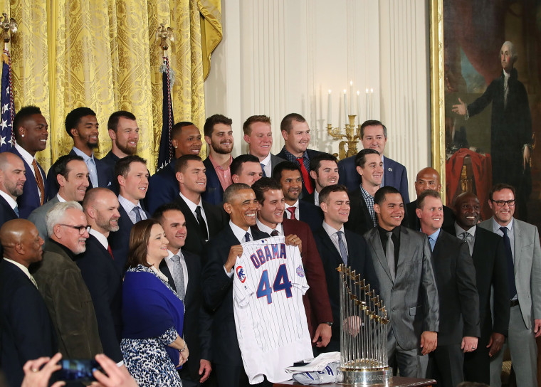 Image: poses for a picture with members of the 2016 World Series Champion Chicago Cubs