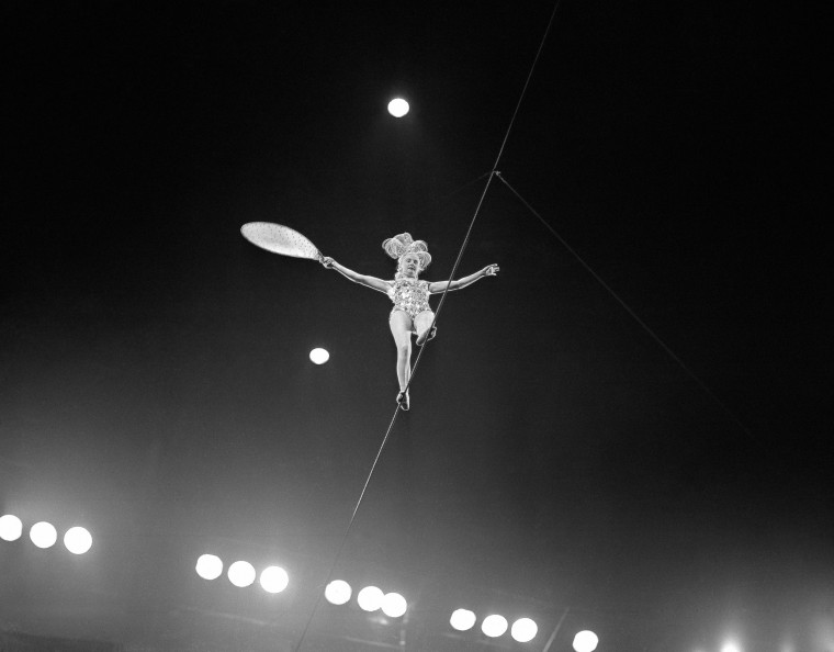 Image: A tightrope walker performs for the circus on May 27, 1955.