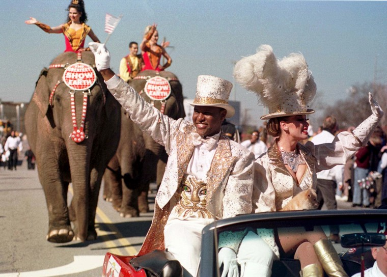 Image: Ringmaster Jonathan Lee Iverson and Catherine Hanneford lead a parade through downtown Atlanta on Feb. 21, 2000, marking the first return for the circus to Atlanta in some 80 years.