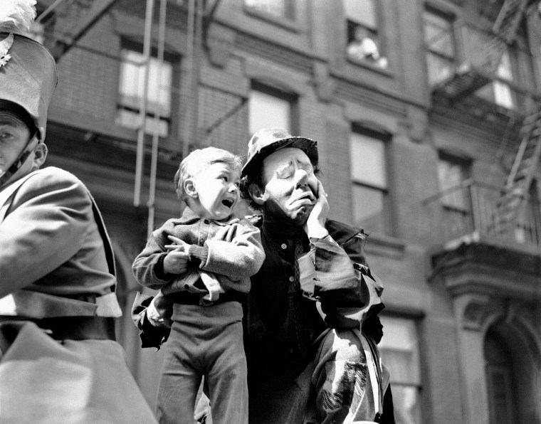 Image: Three-year-old Richard Caglione sheds tears as a stranger, in this case, Emmett Kelly, featured clown with Ringling Brothers and Barnum and Bailey Circus, picks him up during New York's first circus parade in 19 years on April 9, 1945.