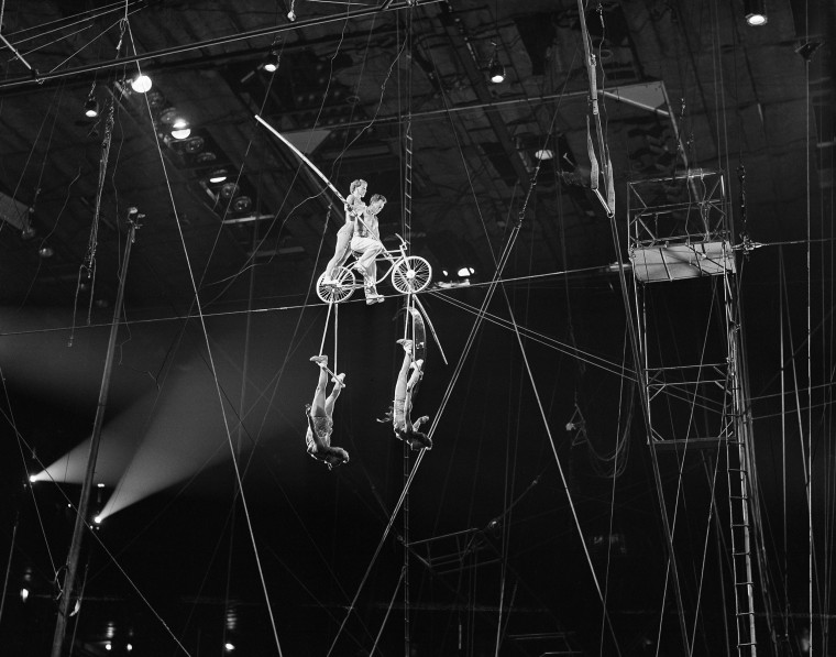 Image: Harold Alzanas on the bicycle during the high wire Alzanas act of the big show at Madison Square Garden, April 12, 1951.