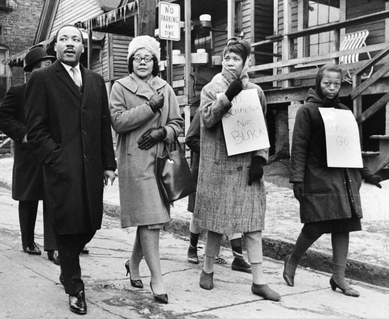 Image: King and his wife, Coretta, second from left, join pickets during a tour of an Atlanta area slum
