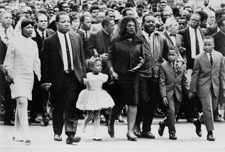 Image: The family of Dr. Martin Luther King, Jr. walk in the funeral procession of the slain civil rights leader