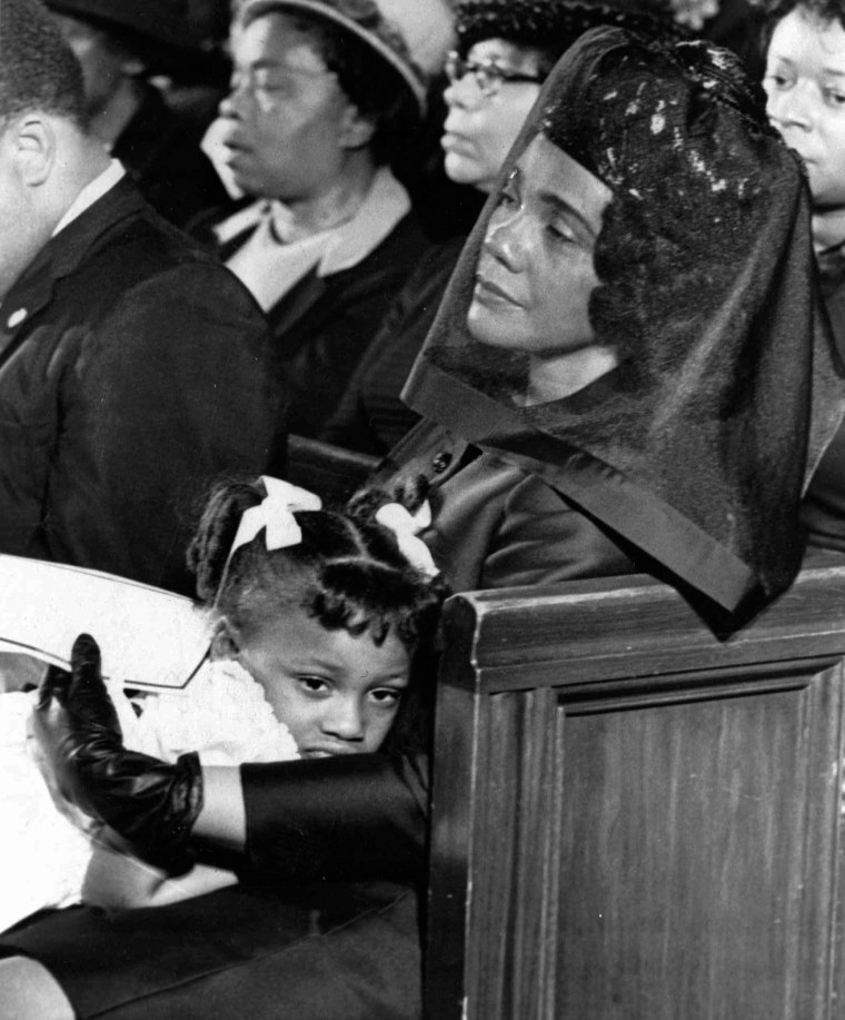 Image: Coretta Scott King and her daughter, Bernice, attend the funeral of her husband