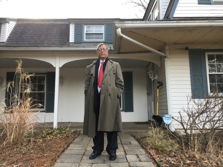 Mohammad Ali Chaudry, president of the Islamic Society of Basking Ridge, at the entrance of the house he wants to raze to build a mosque.