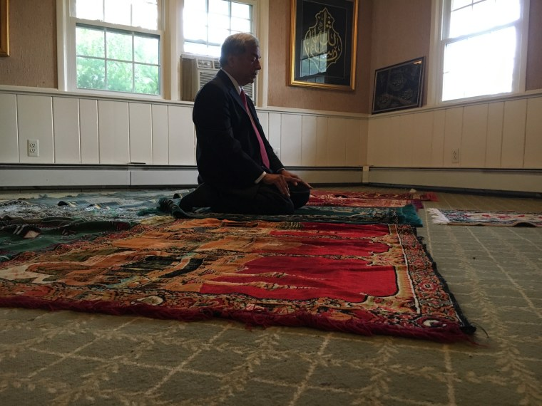 Mohammad Ali Chaudry, president of the Islamic Society of Basking Ridge, prays in the two-story home he is suing to turn into a mosque.