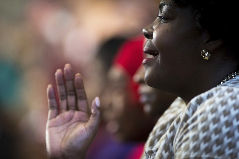 Image: A woman sings during the Rev. Martin Luther King Jr. holiday commemorative service at Ebenezer Baptist Church on Jan. 16 in Atlanta, Georgia.