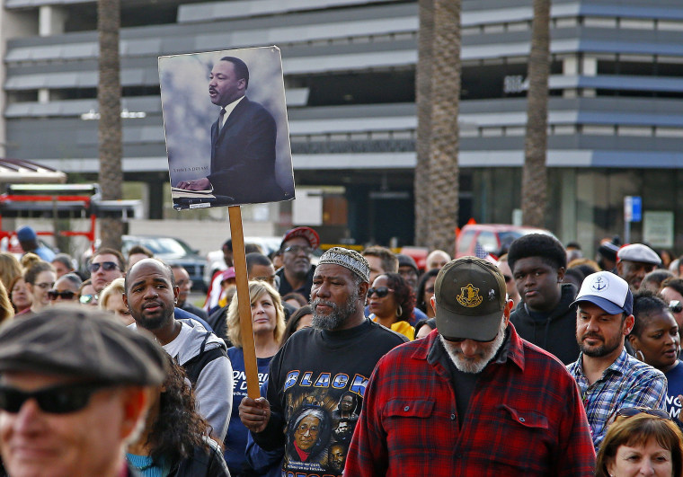 Image: Participants walk during a Martin Luther King Jr. Day march on Jan. 16 in Phoenix, Arizona.