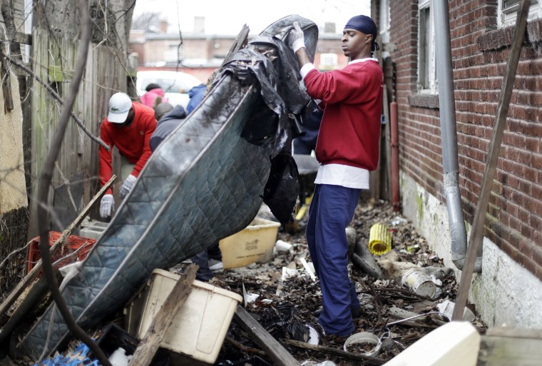 Image: Brandon Nelson helps to clear trash from a vacant house and yard on Martin Luther King Jr. Day on Jan. 16, 2017, in Memphis, Tennessee.
