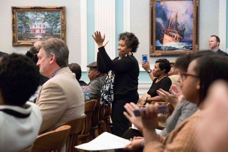 Image: Eula Crowell, wife of Biloxi NAACP President James Crowell, III, and others clap in support as the Biloxi City Council votes unanimously in favor of changing an old ordinance that referred to the Dr. Martin Luther King Jr. National Holiday as ''Gre