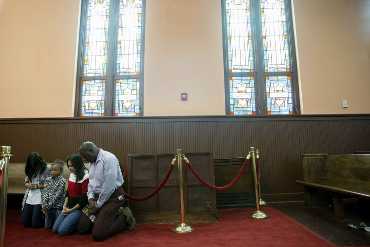 Image: A family prays together inside the Historic Ebenezer First Baptist Church where Martin Luther King Jr. preached on Jan. 16 in Atlanta, Georgia.