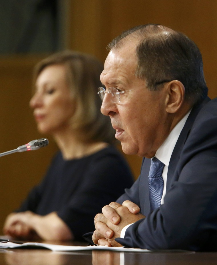 Image: Sergei Lavrov gives a news conference with foreign ministry spokeswoman Maria Zakharova.