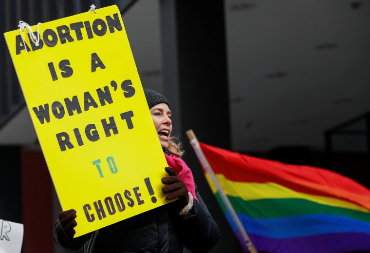 Image: Anti-Trump demonstrator protests at abortion rights rally in Chicago