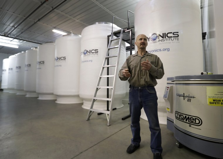 Andy Zawacki, the facility manager at the Cryonics Institute stands next to storage containers at the facility, on Nov. 21, 2016 in Clinton Township, Michigan. The remains of a 14-year-old London girl whose dying wish was to be cryogenically preserved with the hope she could continue her life in the future when cancer is cured are being kept at the institute. The unidentified girl's remains were brought to the facility in October 2016 after a British High Court judge granted her wish.