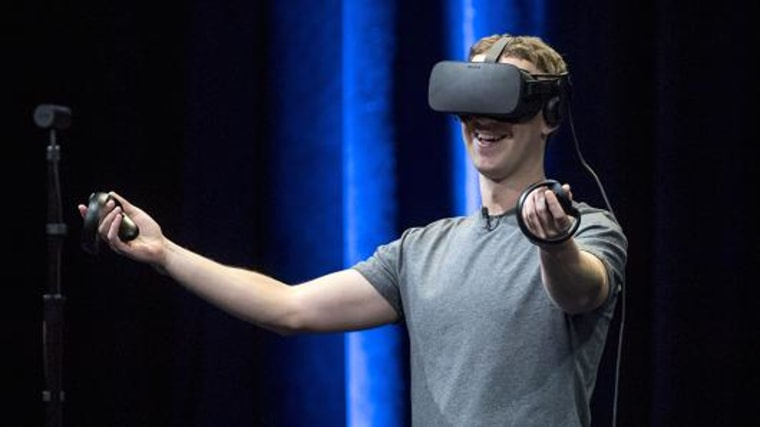 Mark Zuckerberg, chief executive officer and founder of Facebook, demonstrates an Oculus Rift virtual reality headset and Oculus Touch controllers.