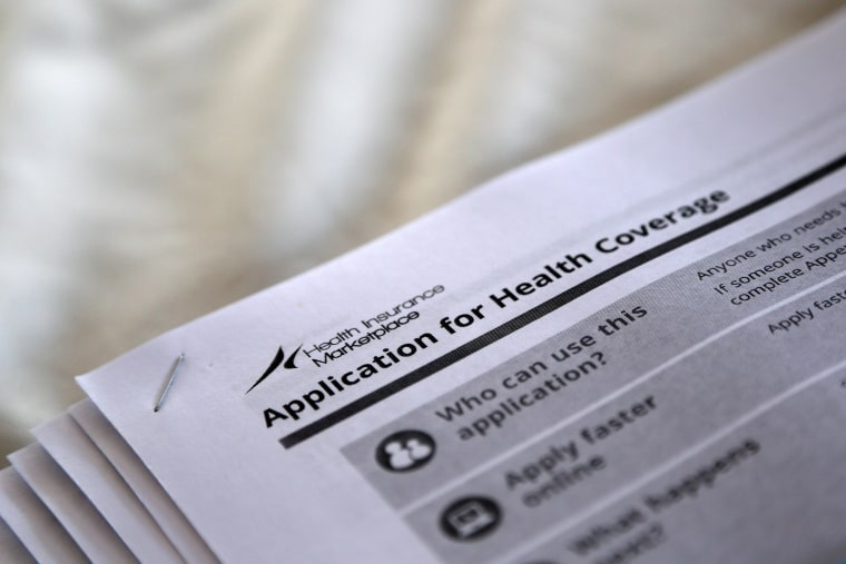 Image: FILE PHOTO - Applications are seen at a rally held by supporters of the Affordable Care Act in Jackson Mississippi