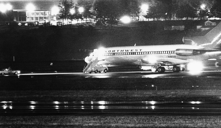 Image: A hijacked Northwest Airlines jetliner 727 sits on a runway for refueling at Tacoma International Airport, Nov. 25, 1971, Seattle, Wash.
