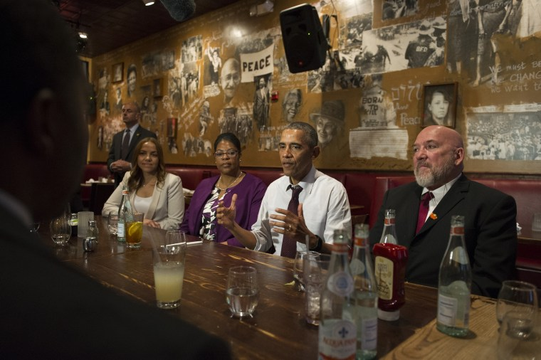 Image: President Barack Obama speaks to the media after having lunch with formerly incarcerated individuals who have received commutations, at Bus Boys and Poets restaurant on March 30, 2016 in Washington, D.C.