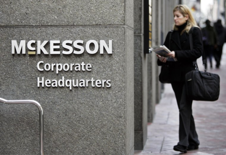 Image: A woman walks into McKesson Corporation's headquarters in San Francisco on Jan. 31, 2008.