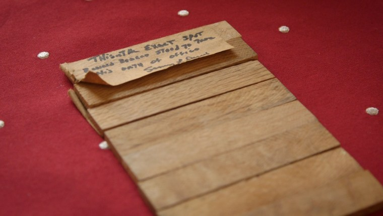 Sammy Lee Davis grabbed a wooden platform board taken from Ronald Reagan's first presidential inauguration in 1981.