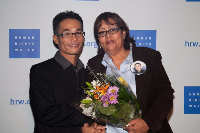 "Tung Nguyen with Luz Ruiz, mother of a murder victim, at a 2012 performance of ""Cries from the Heart"" presented by Human Rights Watch."