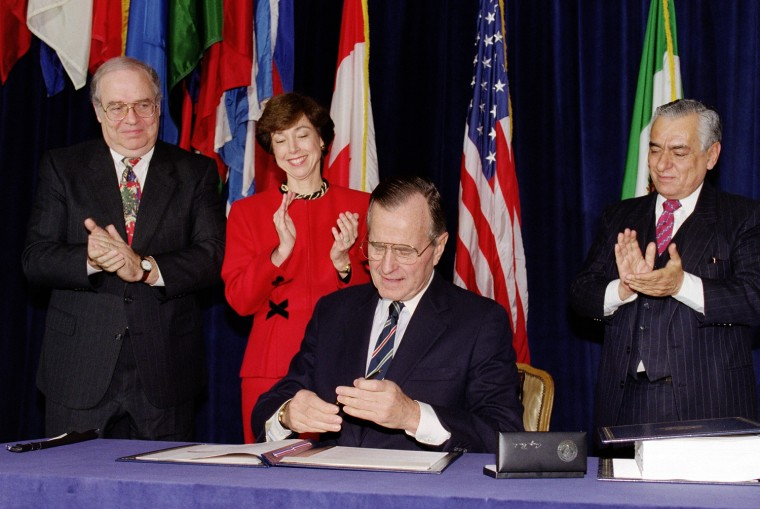 US President George Bush caps his pen after signin