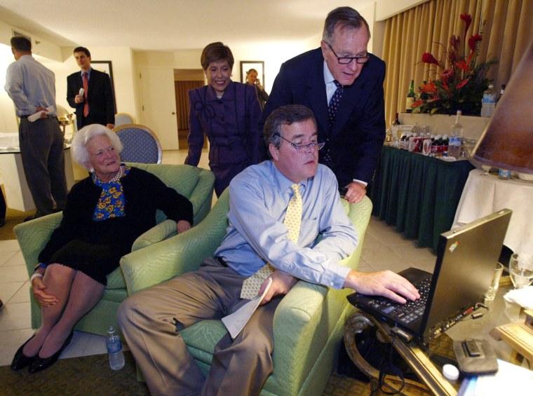 Florida Governor Jeb Bush (R) consults early vote