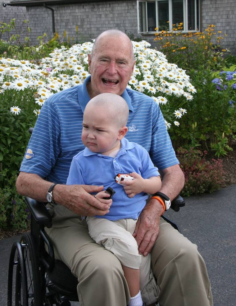 Image: Former President George H.W. Bush is pictured after joining members of his Secret Service detail in shaving his head to show his support for Patrick, , the two year-old son of a detail member who is being treated for leukemia.