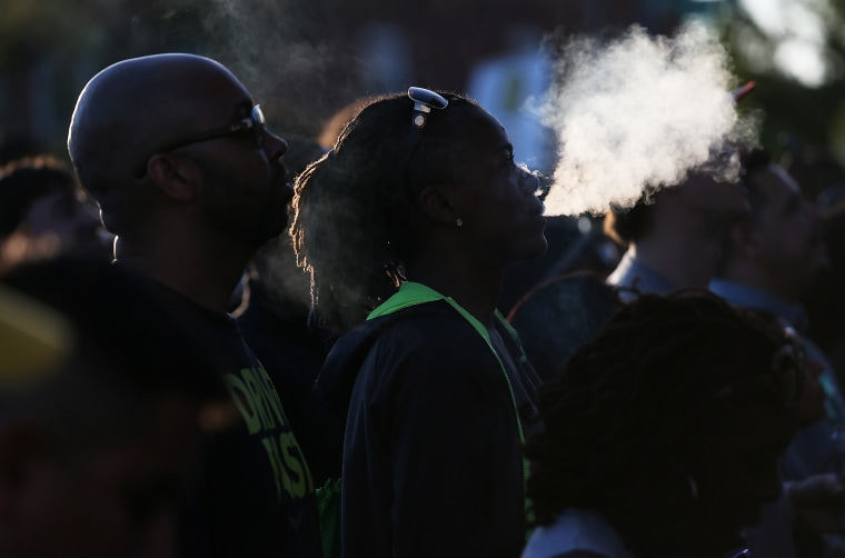 Image: Advocates for marijuana legal reform listen to music while attending the first annual National Cannabis Festival on April 23, 2016 in Washington, D.C.