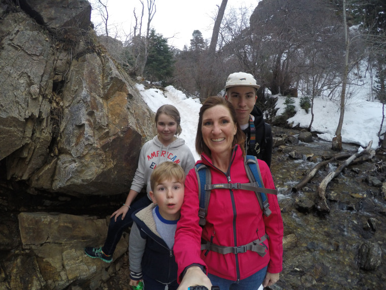 Ginger Johnson, 41, takes a family selfie on a hike with her three children in Adams Canyon in the Wasatch Mountains, Utah. Johnson, who is battling cancer, recorded videos to the SafeBeyond platform that her children will receive at a specified time after she dies.