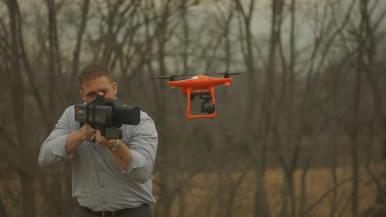 Josh Desmond simulating use of a DroneShield gun that can ultimately bring down a drone.
