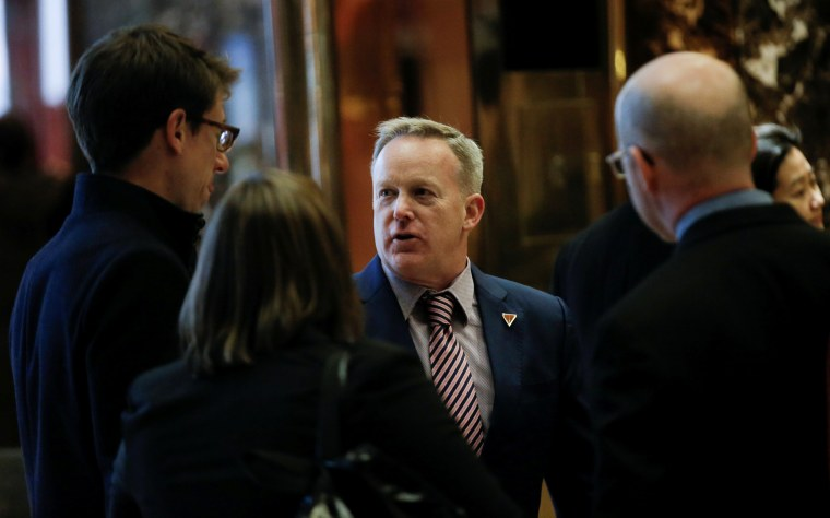 Image: Sean Spicer, Press Secretary to U.S. President-elect Trump, greets representatives of the White House Correspondents Association in the lobby of Trump Tower ahead of their scheduled meeting in New York