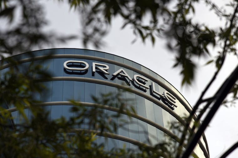 Image: The Oracle sign is displayed on a building at the Oracle Corp. headquarters campus in Redwood City, Calif.