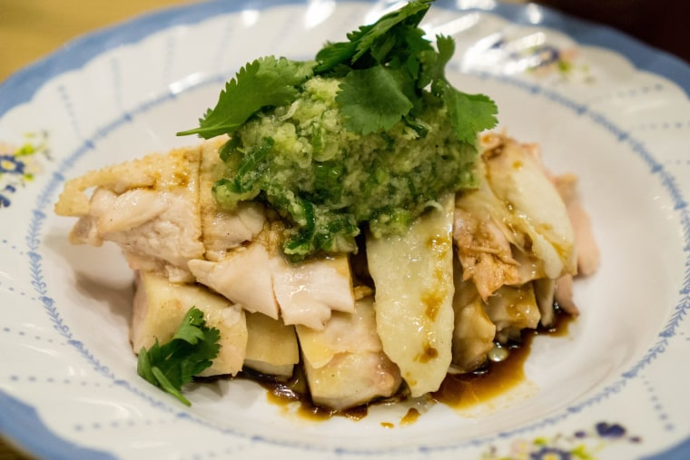 White cut chicken is a traditional Lunar New Year dish representing prosperity and togetherness.