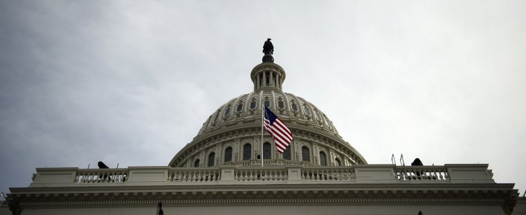 Image: A view of the US Capitol building before tomorrow's Inauguration
