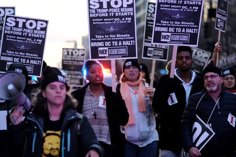 Image: Anti-Trump demonstrators organized by RefuseFascism.org march through the streets of Washington, D.C. on Jan. 18, 2017.Duggan
