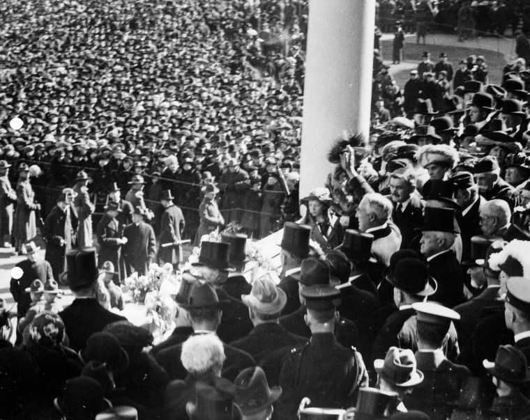Image: Warren Harding waves to the crowd after being sworn in on the east portico of the U.S. Capitol in Washington, D.C. in 1921.