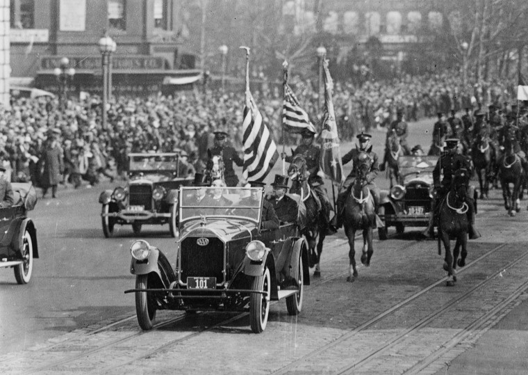 Image: President Calvin Coolidge rides in a car during his inaugural parade in Washington, D.C. in March, 1925.