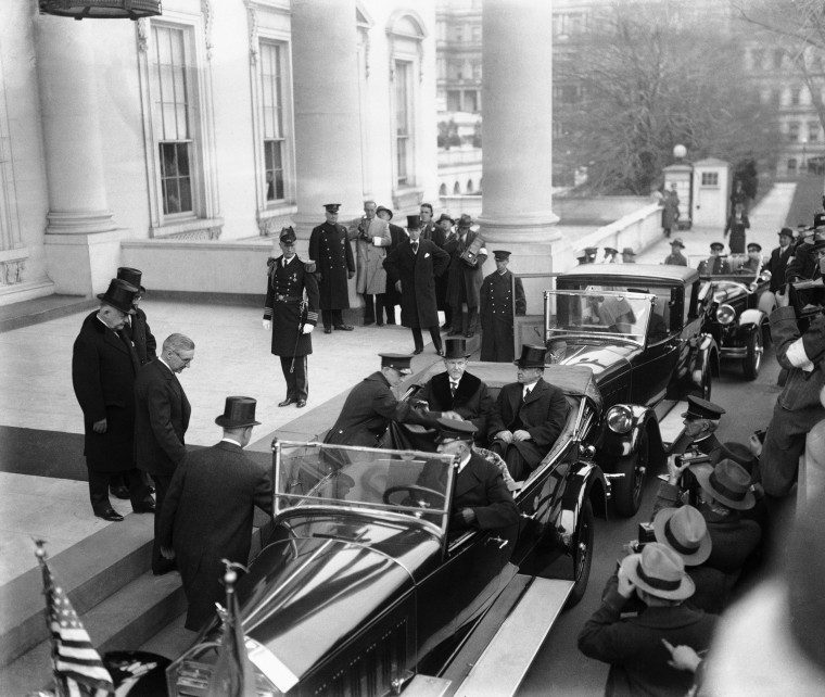 Image: President Calvin Coolidge and President-elect Herbert Hoover, seated in car, leave the White House for Hoover's inauguration on March 4, 1929.