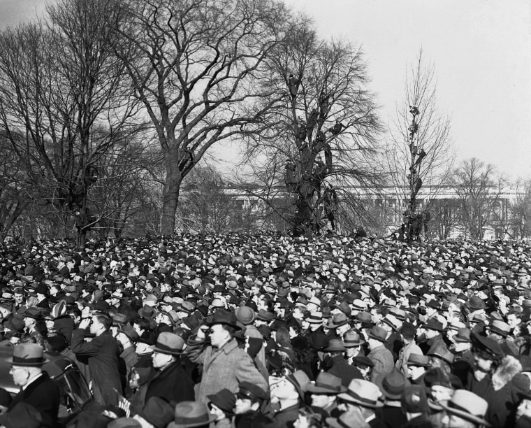 Image: Crowds that came to see President Roosevelt's inauguration for his third term climb trees to get a better view of the ceremony in Washington, D.C. on Jan. 20, 1941.