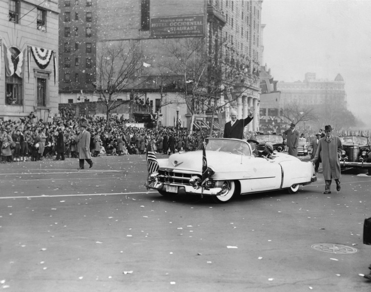 Image: President Dwight David Eisenhower waves to the crowd from his open-topped Cadillac Eldorado after his Inauguration Ceremony and parade in Washington, D.C. in 1953.