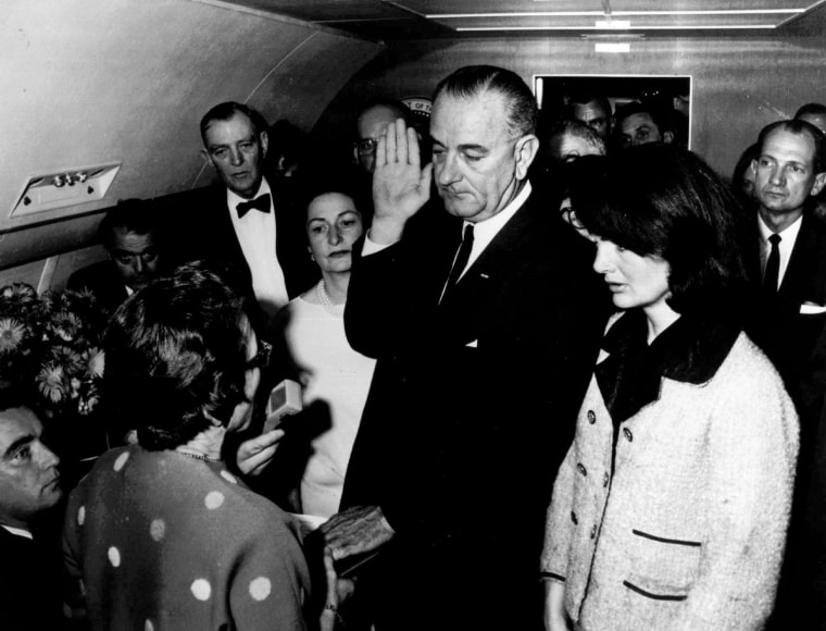 Image: Lyndon B. Johnson is sworn in as President of the United States of America in the cabin of the presidential plane as Mrs. Jacqueline Kennedy stands at his side on Nov. 22,1963.