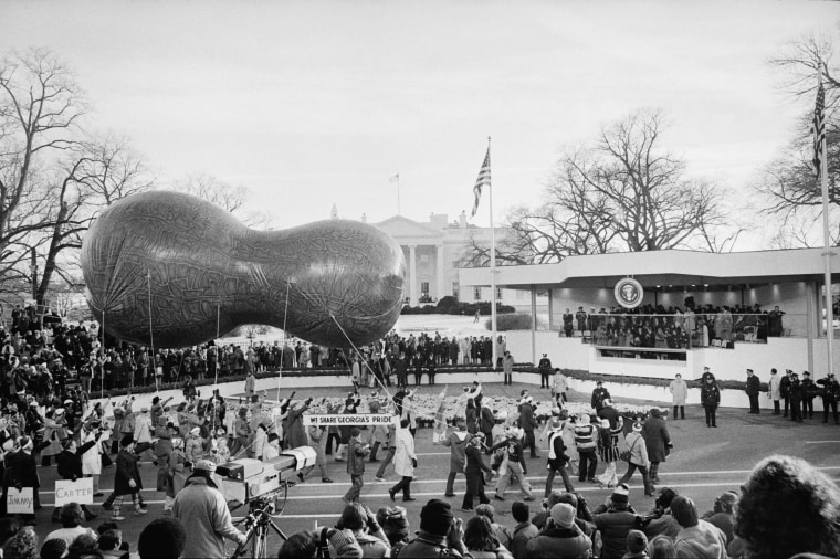 Image: A peanut-shaped float passes by the Review Stand for the inauguration of Jimmy Carter in Washington, D.C. in Jan. 1977.
