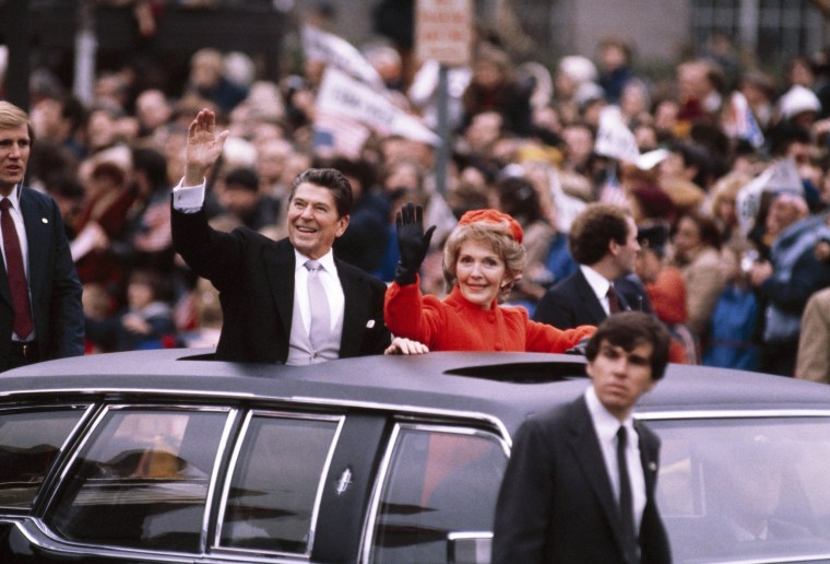 Image: President Ronald Reagan and First Lady Nancy Reagan wave to the crowd from the presidential limousine as they ride down Pennsylvania Avenue during the Inaugural parade on Jan. 20, 1981 in Washington, D.C.