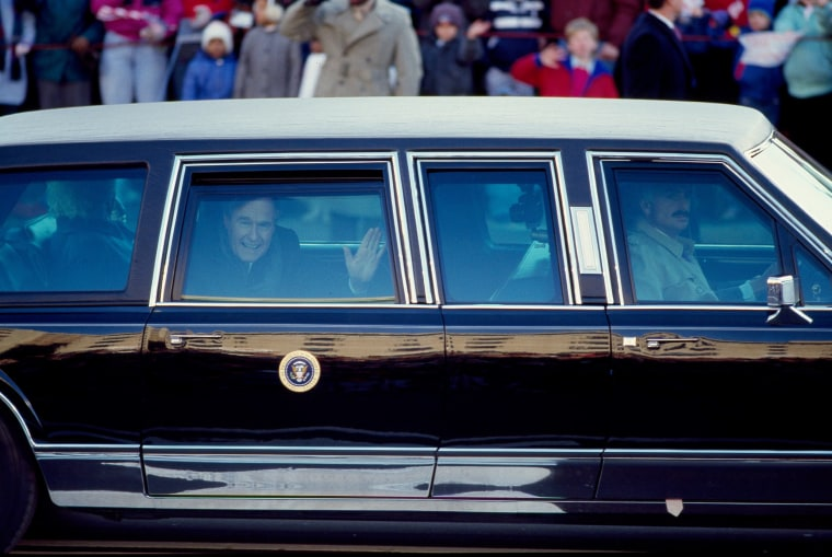 Image: President George H. W. Bush waves from the presidential limousine during his inaugural parade in Washington, D.C. in Jan. 1989.