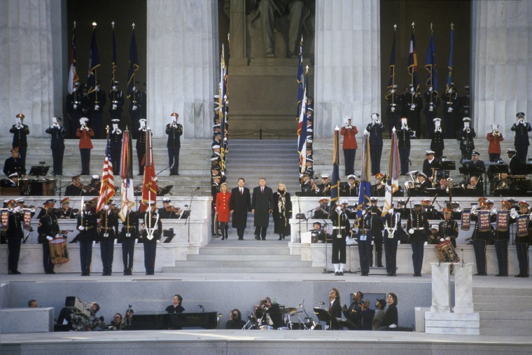 Image: President Bill Clinton, along with First Lady Hillary Clinton, Vice President Al Gore and his wife Tipper Gore attend the Lincoln Memorial Opening Concert's pre-Inaugural event on Jan. 17, 1993 in Washington, D.C.