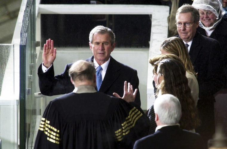 Image: George W. Bush is sworn in as president of the United States by Chief Justice William Rehnquist on the West Front of the U.S. Capitol.