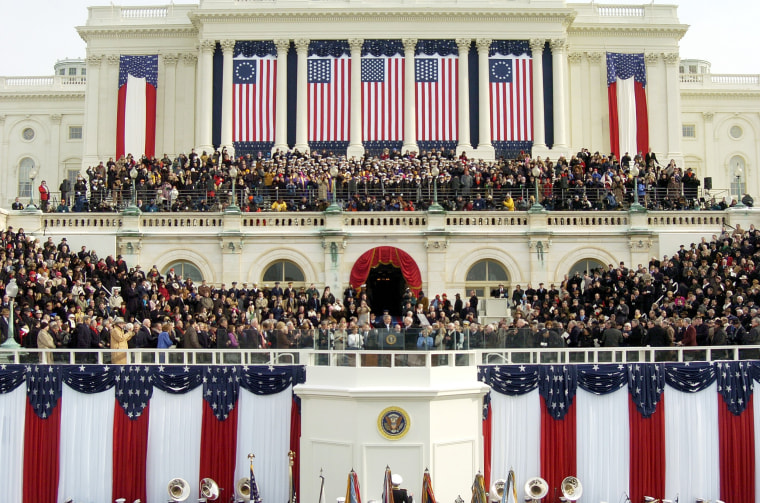 Image:  President George W. Bush and Vice President Dick Cheney stand on the stage during Inauguration Day ceremonies on the west front of the U.S. Capitol on Jan. 20, 2005 in Washington, D.C.
