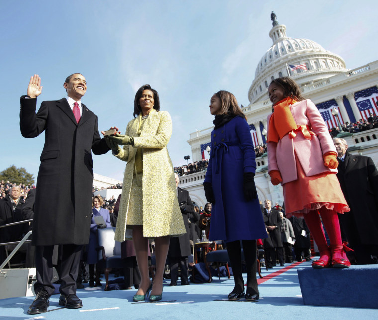 Image: President Barack Obama takes the oath of office with his wife, Michelle, by his side at the U.S. Capitol in Washington, D.C. on Jan. 20, 2009. The Obamas were joined by their daughters, Malia and Sasha.